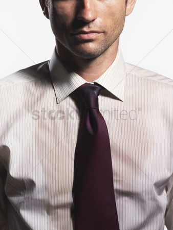 Firing : Sweaty young businessman mid section