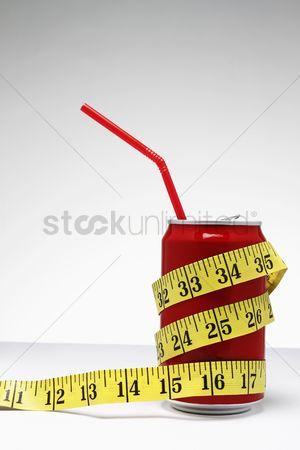 Obsessive : Tape measure on soda can with straw