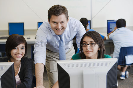 Educational : Teacher and students in computer lab