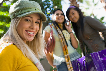 Shopping background : Teenage girls  16-17  smiling outdoors  portrait