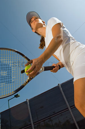 Match : Tennis player holding ball and racket preparing to serve low angle view