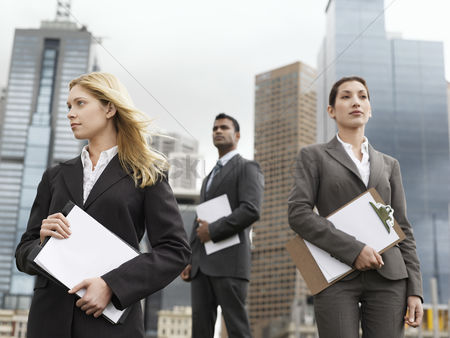 Office worker : Three business people with clipboards outside office buildings