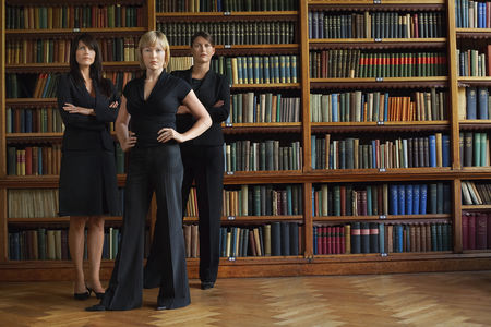 Business suit : Three lawyers in library standing