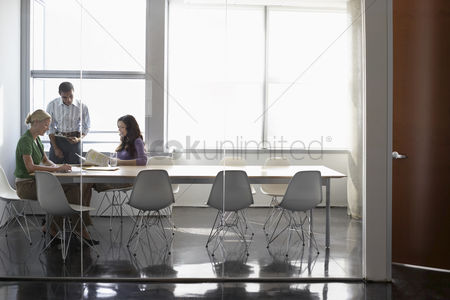 Relationship : Three office workers in conference room