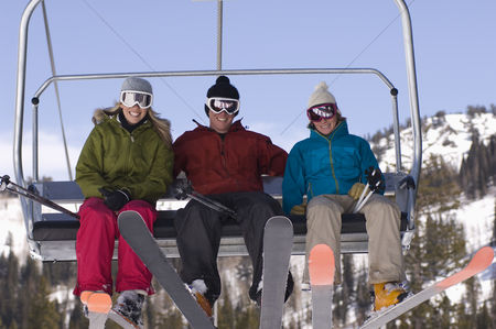 Women group outside : Three skiers on chair lift