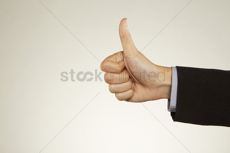 Malaysian chinese : Thumbs up hand gesture
