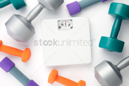 Strong : Top view of dumbbells and weight scale on white background with copy space