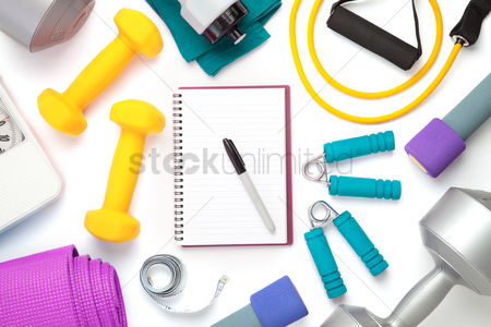 Strong : Top view of fitness equipment and notebook on white background with copy space