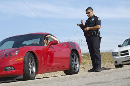 Car : Traffic cop standing by sports car