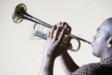 Arts : Trumpeter playing looking up close-up side view