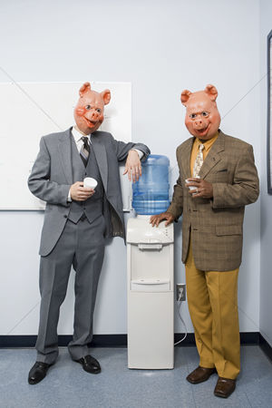 Interior : Two businessmen in pig masks