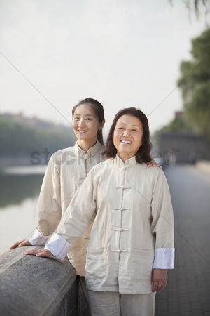 Forbidden : Two chinese women with tai ji clothes smiling at camera