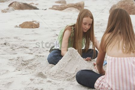 Day off : Two girls playing on beach