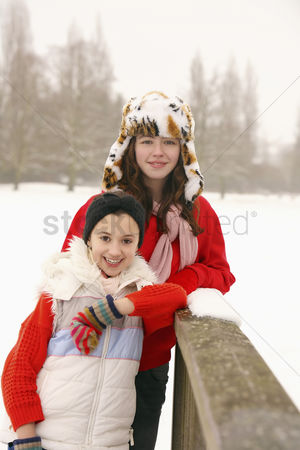 Cold temperature : Two girls standing outdoors in snow
