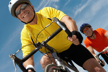 Heart : Two men on bicycle ride portrait low angle view