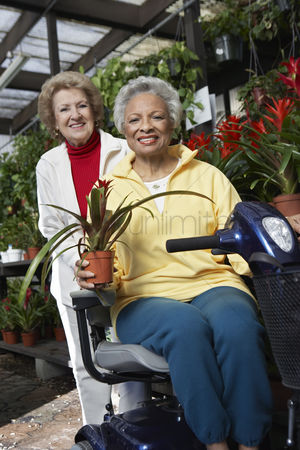Greenhouse : Two senior women in garden center