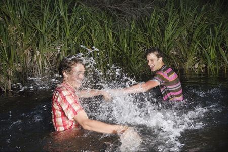 Fight : Two teenage boys  16-17 years  messing about in water splashing
