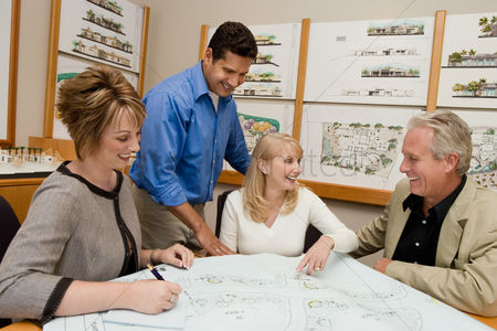 Hispanic : Two women meeting with architect and developer