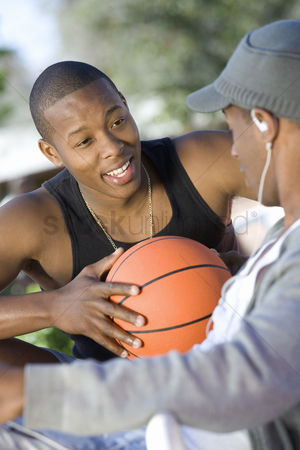 Satisfying : Two young men with basketball talking