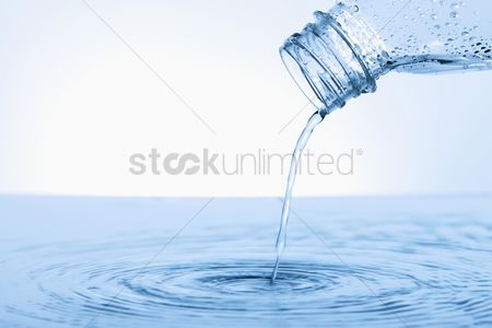 Refreshment : Water pouring from plastic bottle