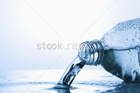 Loss : Water spilling from plastic bottle