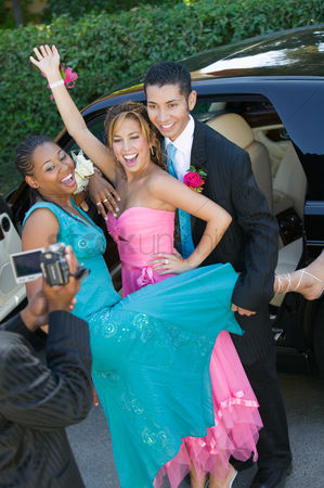 Dance : Well-dressed teenage couples posing an video taping selves outside