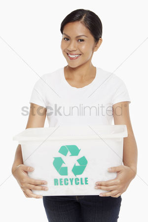 Bidayuh ethnicity : Woman carrying a plastic box with a recycle logo on it