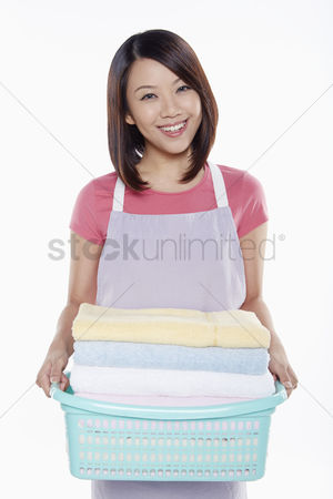 Apron : Woman carrying a stack of clean towels