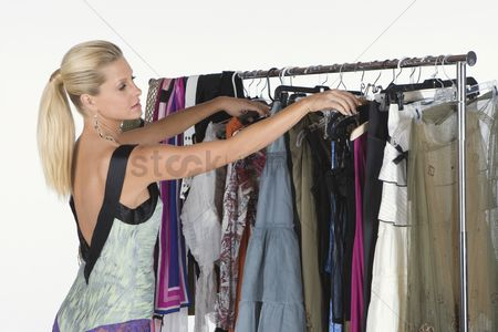 Selection : Woman chooses from a selection of items on a clothes rail