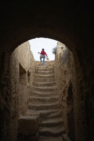 Steps : Woman climbing stairs in the tombs of the kings paphos cyprus