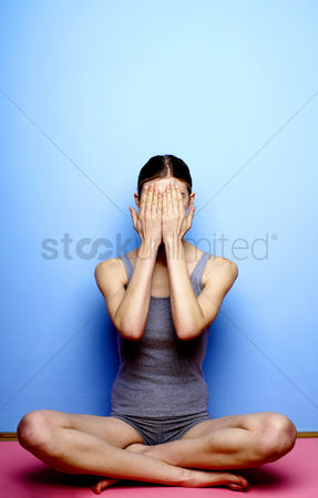 People : Woman closing her face