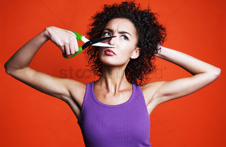 Funny : Woman cutting her nose with a scissors