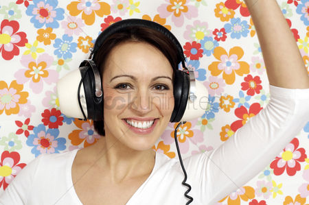 Dancing : Woman dancing while listening to music on the headphones