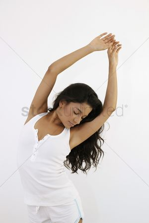 Dancing : Woman dancing with her arms raised