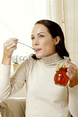 Satisfying : Woman eating honey