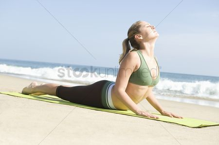 Fitness : Woman exercising at beach