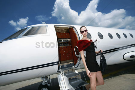 Transportation : Woman exiting private jet