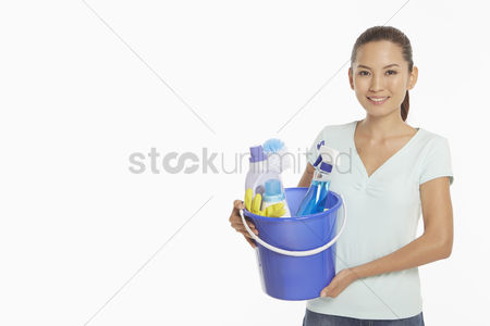 China : Woman holding a bucket filled with cleaning supplies