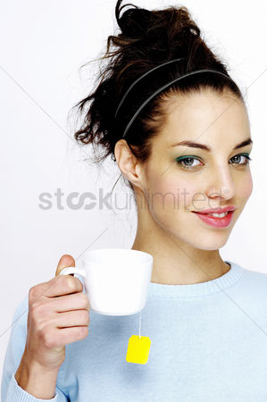 Appetite : Woman holding a cup of tea