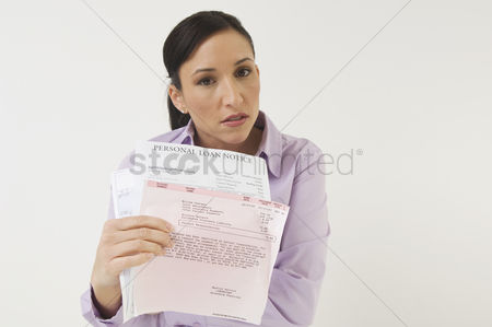 Posed : Woman holding bills