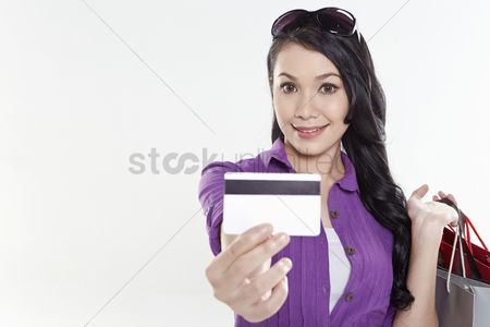 Malay : Woman holding out credit card