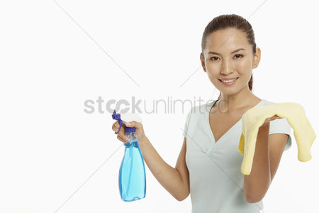 China : Woman holding up a cloth and a spray bottle