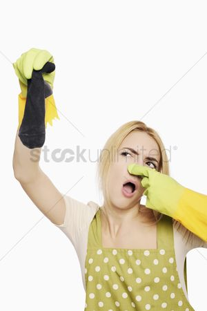 Housewife : Woman holding up a dirty sock