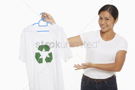 Bidayuh ethnicity : Woman holding up a t-shirt with a recycle logo on it