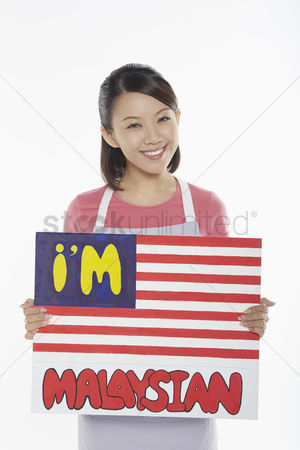 Nationality : Woman holding up an im malaysian