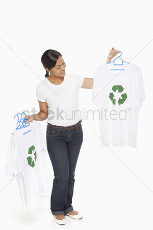Bidayuh ethnicity : Woman holding up t-shirts with a recycle logo on it