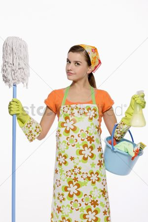 Housewife : Woman in apron holding mop and a pail of cleaning products
