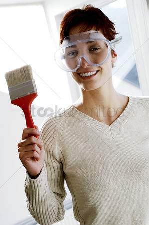 Paint brush : Woman in goggles holding a paintbrush
