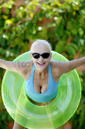 Seniors : Woman in inflatable ring