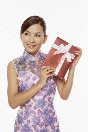 Lunar new year : Woman in traditional clothing holding a red gift box